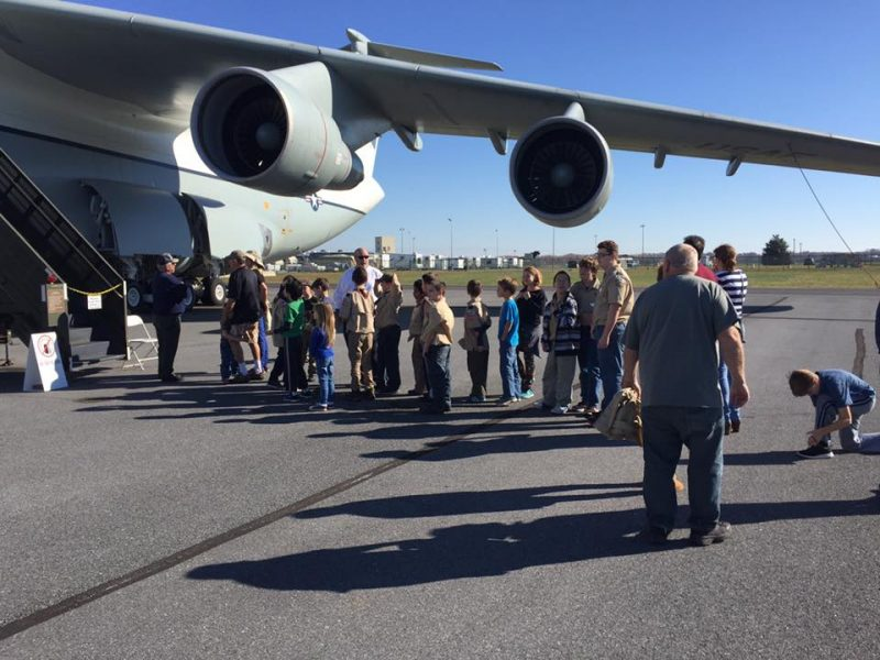 Scouts lining up outside a military plane for a tour