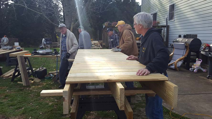 Men working on a wood ramp
