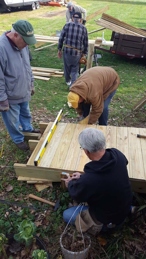 People building a wooden ramp