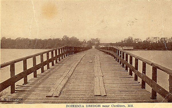 Old yellowed photo of the wood plank Bohemia bridge