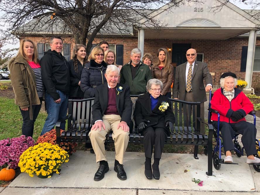 Group of people in front of retirement home