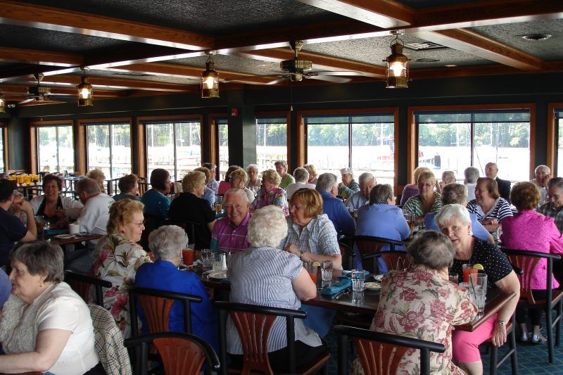 Group of people sitting inside at tables