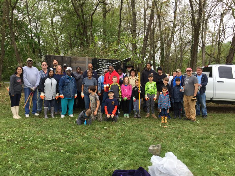 Group photo of volunteers during a town cleanup event