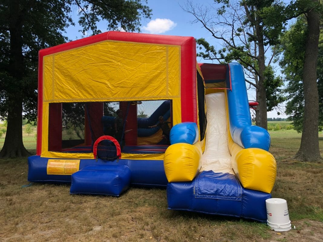 Blow up bouncy castle with slide connected to it