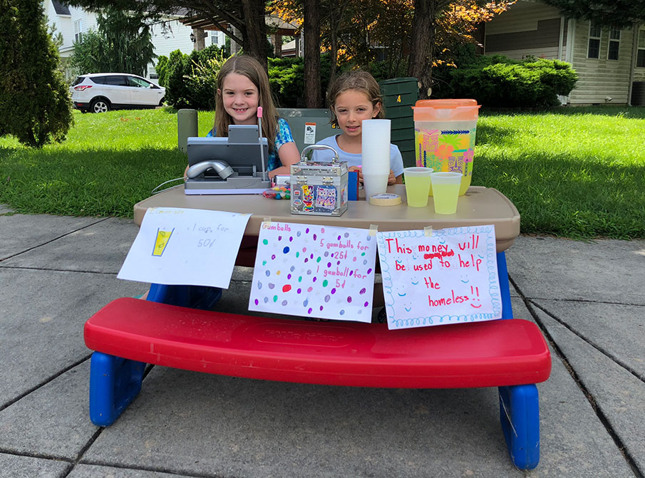 Two girls selling lemonade