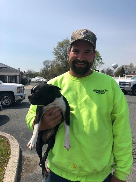 John Rehfuss holding a Boston Terrier